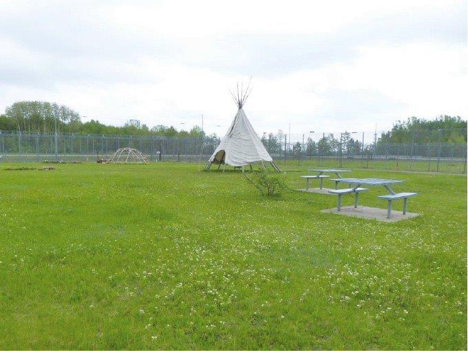A photo of the Sacred Grounds for Indigenous offenders in a federal penitentiary. Description follows.