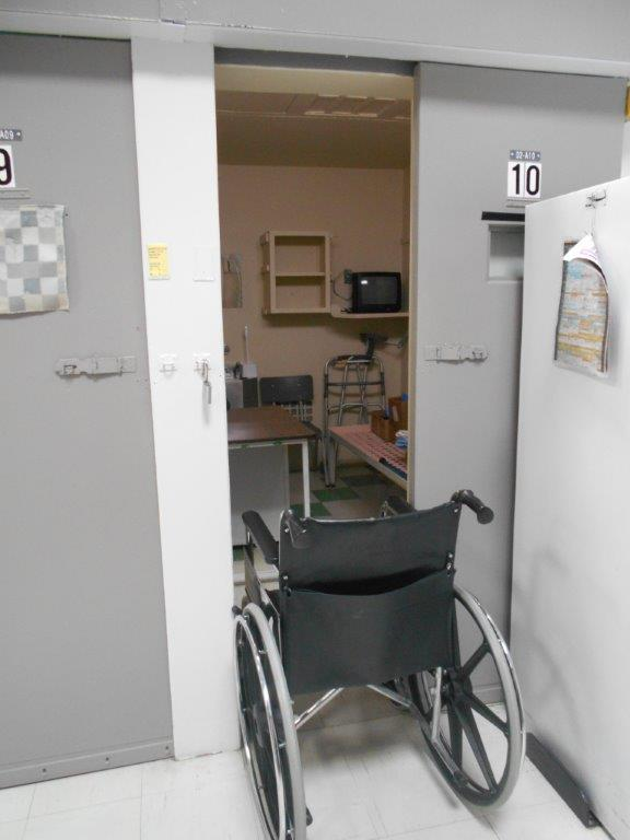 Photo of a wheelchair that cannot fit through a cell door at the Federal Training Centre