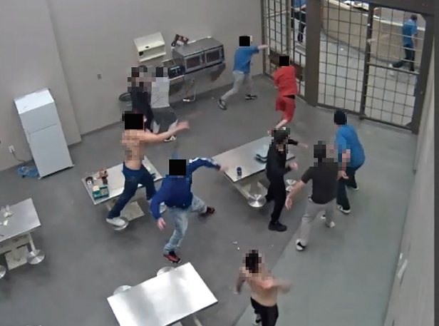 A CCTV capture showing inmates throwing food at protected status inmates in Edmonton Institution
