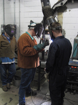 Photo of individuals participating in CORCAN welder training at Collins Bay Institution