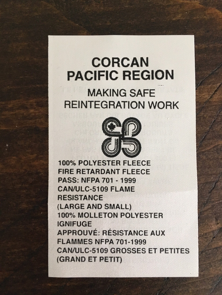 Photo of a clothing tag at the Pacific Region CORCANn
